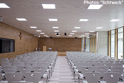 Auditorium with neutral-white lighting – Maria Ward schools
